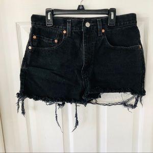 Vintage distressed Levi booty black denim shorts